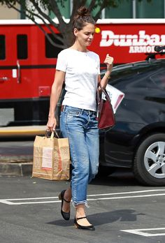 Katie Holmes in a white t-shirt, cropped jeans and Mary Jane flats.