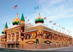 """The original Corn Palace, called """"The Corn Belt Exposition"""" was established in 1892. Early settlers displayed the fruits of their harvest on the building exterior in order to prove the fertility of South Dakota soil. The third and present building was completed for it first festival at the present location in 1921.  (2011)"""