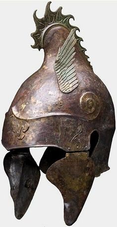 Rare Griffin-crested Greek Chalcidian Helmet, 4th cent. BC. The Chalcidian helmet was especially popular in Greece in the fourth and fifth centuries BC. This style was also worn extensively in the Greek colonies of Italy during the same period. The helmet is so-called because it was first, and is most commonly depicted on pottery once thought to derive from the Euboean city of Chalcis. In fact, it is not known whether the helmet actually originated in Chalcis; indeed, it is not known whether…