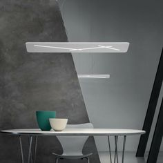 A rectangle with rounded edges reveals definite, rigorous blades of light. The minimalist design is expressed in the daring intersecting linear signs and pa. Office Lighting, Minimalist Design, Minimalism, Dining Table, Pendant, Furniture, Lamps, Group, Home Decor