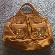 Steve Madden handbag Mustard Yellow handbag with gold studs on the front pocket Steve Madden Bags Shoulder Bags