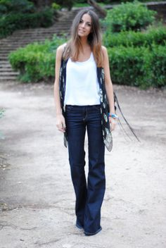 how to wear flares, flared trousers, woman wearing leather jacket ...