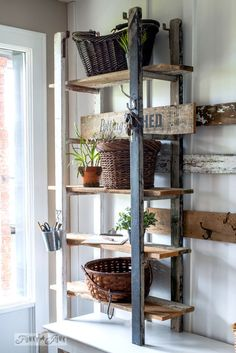 Quirky 2 ladder shelving in the entry. Two identical wooden ladders line up, creating the perfect rusting shelving with basket storage for an entry!
