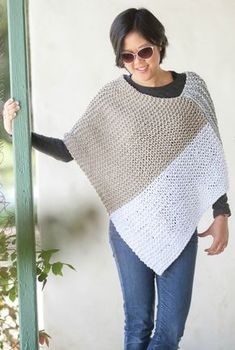 Free Knitting Pattern for Easy Catalunya Colorblock Poncho = Easy poncho knit in stripes in a garter stitch rectangle and seamed. Quick knit in super bulky yarn. Suitable for beginners according to designer ChiWei Ranck of One Dog Woof. Rated easy by Ravelrers.