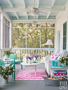 Looking for porch paint ideas? Try a pretty mix of pastels. A gray painted floor and white surroundings allow splashes of turquoise, pink, and violet do the talking. Chippy finishes give this summer porch pretty patina.
