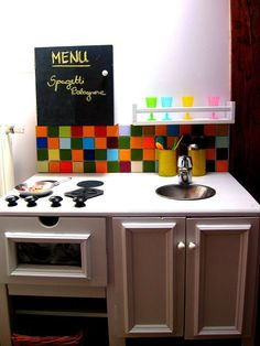 Really cute Play Kitchen .... love the glass storage