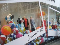 French Connection's London Oxford Street store. I thought the whole concept for the display was really strong, communicating the idea of summer in a  fun way.   The postcard design helped to frame the mannequins and focus your eye on the bright colours of both the clothes and the beach balls. The display stood out really well as you walked down the street as it was completely different to the other retailers windows and filled the whole space with colour and props, creating maximum impact.