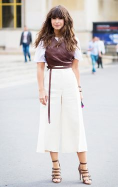 73062f6a618 Miroslava Duma wears a structured leather vest over a white t-shirt with  culottes and