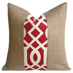 """Eco-friendly indoor/outdoor burlap pillow with a trellis-patterned fabric stripe in red. Made in the USA.   Product: PillowConstruction Material: 100% Natural burlap and cotton cover and down fillColor: RedFeatures:  Made in the USAEco-friendlySuitable for indoor or outdoor useInsert included Dimensions: 20"""" x 20""""Cleaning and Care: Spot clean"""