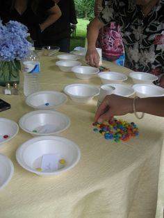 """Minute to Win It Baby Shower Game! """"Separation Anxiety"""": separate your bag of m by color into provided bowls. First to finish wins!"""