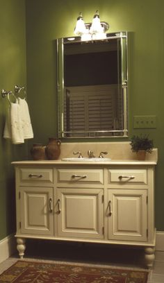 Love this mirror and the green wall color - plan #024D-0048   houseplansandmore.com