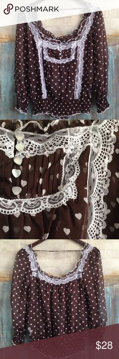Bebe Silk Top Size Small Super feminine Bebe silk top with squared off neckline, 3/4 sleeves, elastic gathered waistline, delicate lace trim and pretty heart print. Size Small. Color Brown/White. Material 100% Silk. Measurements shoulders:14, pits: 16, top to bottom: 23 bebe Tops Blouses