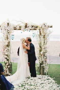 You may kiss the bride - White floral arch | More on: http://mysweetengagement.com/you-may-kiss-the-bride/