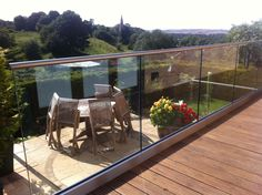 Frameless glass balustrade with toughened glass and dia stainless steel slotted tube top rail. Supplied and fitted by Morris Fabrications Ltd. Frameless Glass Balustrade, Tube, Deck, Stainless Steel, Patio, Outdoor Decor, Home Decor, Terrace, Front Porch