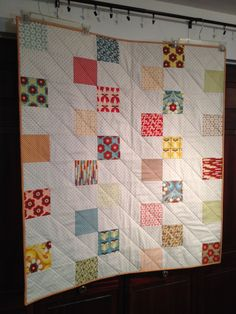 RMM Quilt: Checkmate Baby Quilt, 40x45, made with one Urban Chix charm pack and 1-1/4 yd of background fabric, pattern by Quilting in the Rain-nice, quick quilt with easy diagonal machine quilting