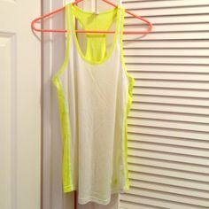 Under Armour Heat Gear Tank Top Ventilated and slightly loose fitting with low arm holes, perfect for layering over a cute sports bra. Can be used for working out and playing sports. Neon yellow back with white front. Slightly wrinkled from being folded, otherwise was only worn once. Under Armour Tops Tank Tops