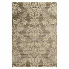Rug with a damask-inspired motif.  Product: RugConstruction Material: PolypropyleneColor: Neutral and green Note: Please be aware that actual colors may vary from those shown on your screen. Accent rugs may also not show the entire pattern that the corresponding area rugs have.Cleaning and Care: Vacuum regularly with non-beater attachment. Blot stains immediately. Test cleaning products in discreet area. Dry clean.