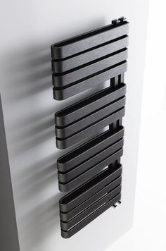 Create a focal point in bathrooms with the iconic design of the Svelte radiator, available in metallic black or soft white - Svelte Towel Warmer from Bauhaus.