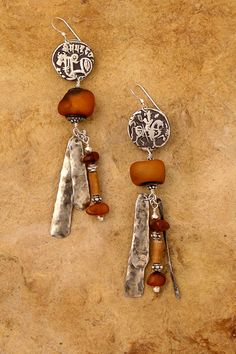 by Patricia Reinking | Old Afghan silver coins, old amber beads, bone and hammered silver dangles | Sold