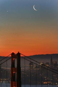 Both the crescent moon and venus paired up and hanging out over San Francisco's skyline at twilight.Photography workshopsoffered with Frederic Larson.