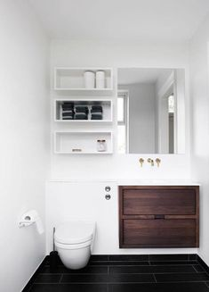 Storage shelves above toilet, ledge above toilet, large draws, gold plumbing, add storage behind mirror - YES! Shelves Above Toilet, Bathroom Storage Shelves, Toilet Storage, Storage Mirror, Ledge Shelf, Storage Shelving, Cabinet Storage, Bedroom Organization, Cabinet Ideas