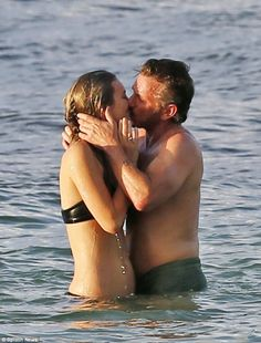 Sealed with a kiss:Sean Penn could not keep his hands off a young blonde whom the DailyMail.com can exclusively reveal is Leila George while in Hawaii on Wednesday