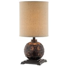 The Otley lamp is simple yet stunning while trending towards vintage styling. The bolted panel in a weathered bronze finish gives the appearance of this accent lamp verve and character. This accent lamp is complemented by its tall drum linen shade.