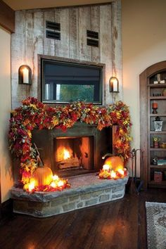 FALL HOME DECOR: If you typically opt for a more minimalist decorating approach, punch up your mantel with a single statement piece. Here, one decorator used a garland of colorful leaves and a couple pumpkins to add drama to a fireplace. Thanksgiving Decorations, Seasonal Decor, Halloween Decorations, Holiday Decor, Halloween Cakes, House Decorations, Harvest Decorations, Fall Mantel Decorations, Christmas Decorations