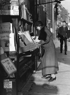 Charing Cross Road, London, 1937  The lady was after some sheet music.This particular shop, Beaumonts, specialised in secondhand music. It was situated in tenement buildings, which were torn down some years ago.