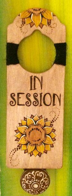 "Rustic wood-burned ""In Session"" door hanger with sunflower artwork & black twine. https://www.etsy.com/shop/DesignsByHeidiLynne"