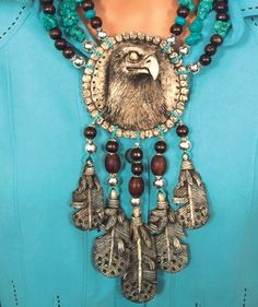 """Stunning, Statement Necklace with Hand-Sculpted Eagle Centerpiece with a Triple-Strand Turquoise and Wooden Beaded Necklace. Five, Resin Eagle Feather Dangles hang from the Proud Eagle... 20"""" with 3"""" Extender Chain... www.maverickrose.com"""