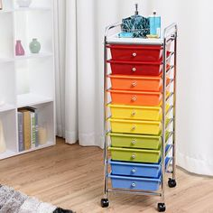 Latitude Run 10 Drawer Rolling Storage Drawer constructed with tubular steel and 10 removable polypropylene drawers in a different color and pull knobs color is same with the drawer. Craft Storage Cart, Rolling Storage Cart, Arts And Crafts Storage, Office Storage, Arts And Crafts Supplies, Locker Storage, Plastic Drawers, Plastic Storage, Mobile Storage