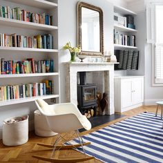 living room with blue striped rug Looking for modern living room ideas? Take a look at this fresh blue and white schemeLooking for modern living room ideas? Take a look at this fresh blue and white scheme Living Room Shelves, Living Room Storage, Rugs In Living Room, Alcove Ideas Living Room, Living Room Ideas Terraced House, Living Room With Stove, Living Room Ideas With Fireplace And Tv, London Living Room, Fireplace Modern