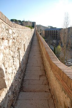 Girona's wall - Girona, Spain;  dates to Roman times;  photo by Alberto OG, via Flickr