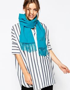 """Scarf by Boutique Moschino Pure merino wool Super-soft-touch finish Embroidered branding Tassel detail Hand wash 100% Merino wool Total length: 180cm/71 """" x 37cm/15"""""""