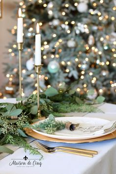 Gorgeous holiday table setting with greens, eucalyptus and gold accents! Classic Christmas table in gold and white---> #maisondecinq #tablescape #tablesetting #christmastable #holidaytable #holidayentertaining #christmastablesetting #holidaytablesetting