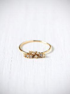 e.m. noir Diamond Cluster Ring at Free People Clothing Boutique