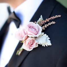 A pink rose boutonniere accented the romantic theme of the wedding.