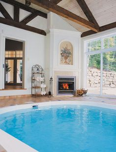 RSF Onyx Fireplace - why not dry off by the fireplace when you jump out of the pool? The radiant heat of a wood burning fire should dry anything nearby quickly. Wood Burning Fires, Radiant Heat, Fireplaces, Swimming Pools, House Design, Mansions, Architecture, Jets, Outdoor Decor
