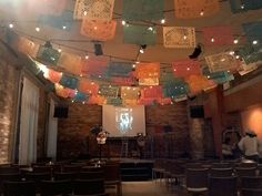 Setting up some visual materials for the launch of Lotería Huasteca at the Gladstone Hotel on November 2, 2015. Photo by Tim Inkster.