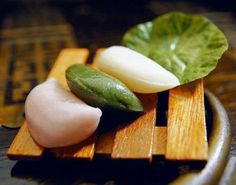 Songpyeon - Crescent moon rice cakes. Songpyeon is a special Chuseok eatery filled with a paste of chestnut, jujube, sesame seeds and red beans. They're tough to make in the beginning due to pounding the rice with a hammer and water.