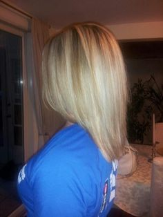 Full highlights with a dark blonde lowlights to create contrast...  the shape of this haircut!! so simple, but beautiful.