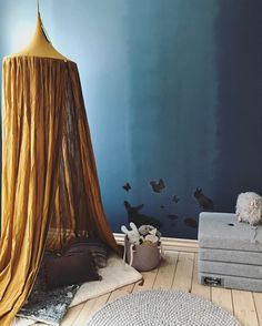 Numero74 Gold Canopy matches perfectly with a contrast blue wall..Lovely styling!