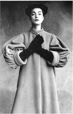 French model Regine Debrise in Balenciaga's grey wool coat, 1950, photo by Irving Penn
