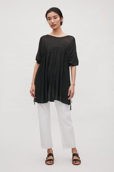 This top is a square-cut shape with tunnelled drawstring details that can be adjusted for a more fitted look. Made from a sheer, fine knit, it is completed with a wide round neckline and short kimono sleeves. Cos Fashion, Short Kimono, Dress Me Up, Black Tops, Knitwear, Normcore, Tunic Tops, Knitting, Sleeves