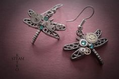 The perfect gift for that someone special! These enchanted dragonflies come straight to you from a Steampunk fairytale near you! Made from Tibetan Silver ,featuring a conundrum of cogs and gears as befits any steampunk artifact, and finished with Swarovski emerald gemstones!  Perfect for any occasion!