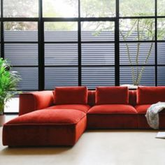 A bold and sumptuous sectional sofa design characterised by a geometric architectural outline, blended with inner soft form. Featuring soft and rectangular back cushions, which sit on a shaped reflex foam seat cushion to give an extremely comfortable sit. Each section connects using a hidden mechanism in the base and can be easily uncoupled when needed. Chunky piping detailing across the design gives an additional touch of style, whilst showing off the best of British upholstery craft.    Living Room With Fireplace, Living Room Sofa, Home Living Room, Living Room Designs, Simple Living Room Decor, Living Room Update, House Extension Design, House Front Design, Lounge Design