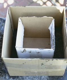 Make a concrete planter by using a smaller box inside the larger one.
