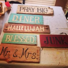 Hand painted signs on old barn wood.