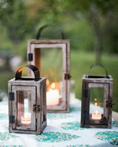 Wooden lanterns are an easy way to cast a warm glow over your tables